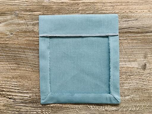 Angles de poche piqués en onglet