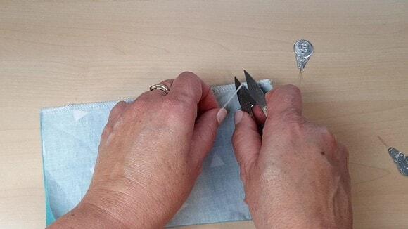 Couper l'excédent de fil de chaînette