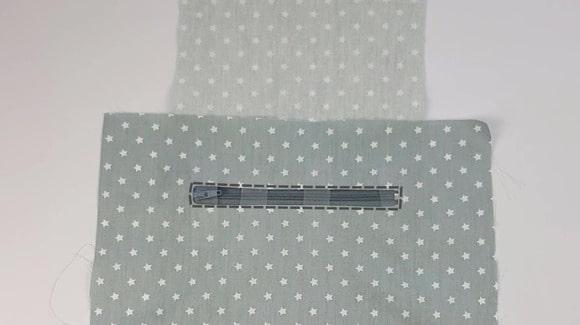 Préparation de la couture de la poche zippée